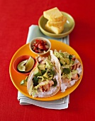 Baja Fish Tacos with a Side of Lime and Salsa