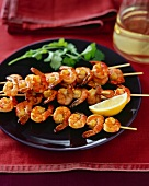 Grilled Mango Curry Shrimp Kabobs with a Lemon Wedge