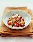 Israeli Couscous with Shrimp and Tomatoes in a Bowl