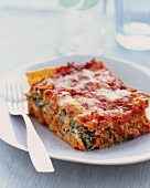 Slice of Veggie Lasagna on a Plate with a Fork