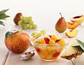 Bowl of Fruit Salad Surrounded by Fresh Fruit