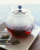 Tea in a Glass Teapot; Bowl of Loose Tea