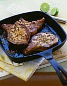 Seasoned Pork Chops in a Cast Iron Skillet