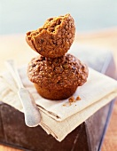 Half a Bran Muffin On Top of a Whole Bran Muffin; Knife