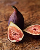 Halved and Whole Figs on a Cutting Board