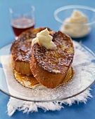 Thick Sliced French Bread French Toast with Butter, Maple Syrup and Powdered Sugar