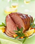 Whole Spiral Cut Ham on a Platter with Citrus Fruit