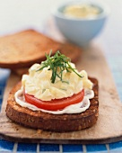 Open Face Egg Salad Sandwich with Tomato and Mayonnaise on Toasted Bread