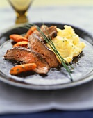 Sliced Flank Steak with Mashed Potatoes and Carrots; Chive Garnish