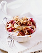 Raspberry and pear crisp with pecan nuts and coconut sauce