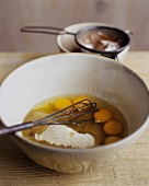Eggs and Dry Ingredients in a Mixing Bowl with Whisk
