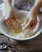Hands Mixing Flour and Butter