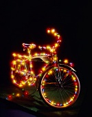 A Bicycle Covered in Christmas Lights
