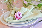 A place setting decorated with flowers on a napkin