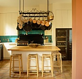 A kitchen counter with bar stools