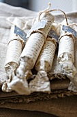 Packages tied with string on linen