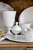 White china on a wooden shelf