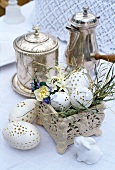 Easter decoration next to silver containers