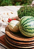 Melons on wicker plates