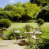 Taking time out on a terrace in a park-like garden