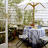 Breakfast under a sunshade on a terrace