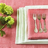 Three cake forks on napkins