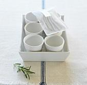 White ramekins in a white dish