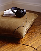 Headphones and CDs on a cushion