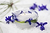 An ice tealight holder decorated with hyacinth flowers