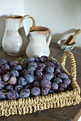 Damsons on a wicker tray