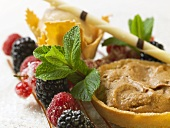 Chestnut cream in tart shells, berries and mint