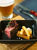 Grilled beef steak with onion chutney, chips and aioli