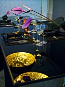 Flowers and wine glasses on laid table