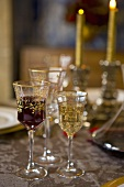 Decorative wine glasses on laid table