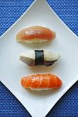 Nigiri sushi made with salmon, mackerel & tuna (overhead)