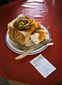 Bunny chow (Loaf of white bread filled with curry, S. Africa)