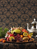 Plate of fruit and silver teapot (Middle Eastern)