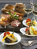 Antipasti (vegetables, salami, prosciutto) with white wine