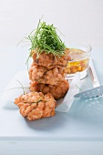 Salmon cakes with red and yellow pepper vinaigrette