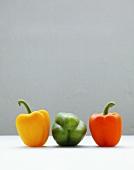 Three peppers (yellow, green, orange)