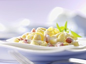 Tortellini with ham and cream sauce and lemon verbena