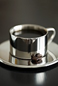 Coffee in silver cup and saucer
