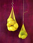 Lemons in net bags (hanging up)