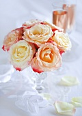 Bouquet of pink roses in a crystal vase