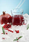 Pomegranate juice and a pomegranate on ice
