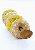 Various bagels on a wooden spoon