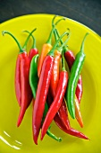 Red and green chilli peppers on a plate