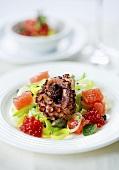 Grilled octopus on fruit salad