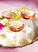 Three champagne cocktails on a tray