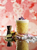 A pineapple drink with lavender flowers